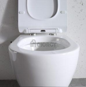 sanitari wc a terra filo muro ceramica bianca forma arrotondata