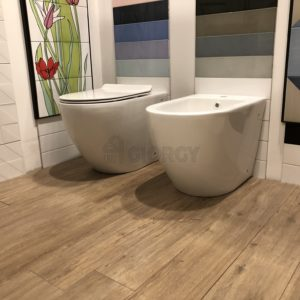sanitari wc bidet a terra filo muro in ceramica bianca forma arrotondata